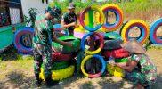 Prajurit Yonmek 512/QY membuat taman warna-warni dengan manfaatkan ban bekas. (Foto: Penerangan Yonmek 512)